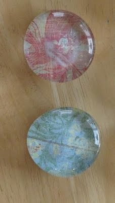2 finished marble magnets made with scrapbook paper
