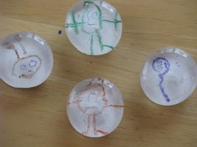4 marble magnets made with kids drawings
