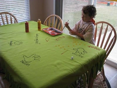 child painting on fleece with paint and brush