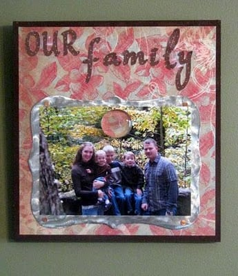 magnetic frame displayed on wall with family photo