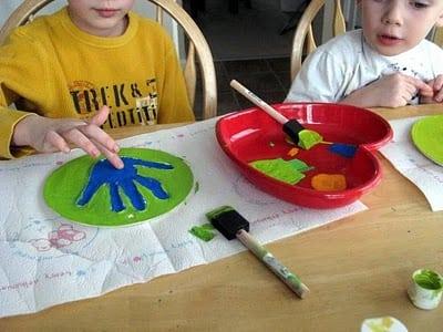 children painting plaster prints