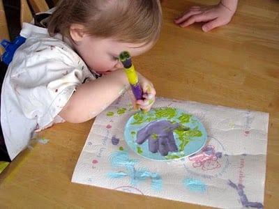 toddler painting plaster handprint