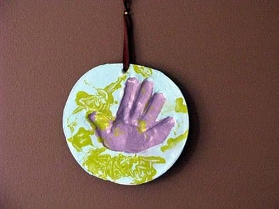 toddler plaster handprint hanging on wall