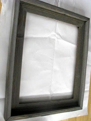frame without glass sitting on work surface
