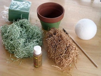 craft grass and paint and flower pot and styrofoam ball