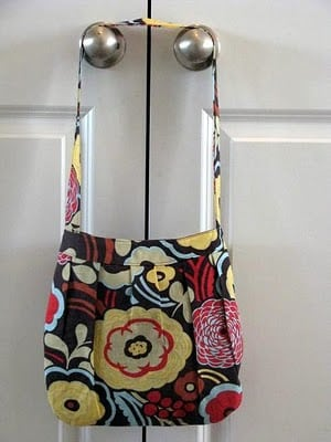 finished buttercup hand bag hanging on door handle