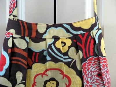 floral handbag hanging on door handle