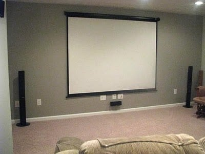 movie screen mounted on grey wall