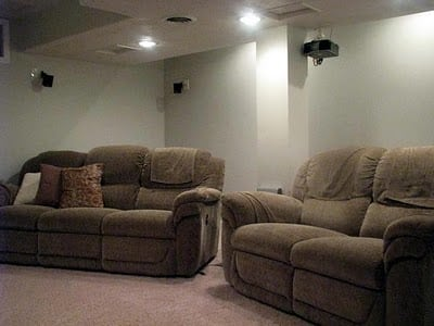 sofa and love seat in movie theater room