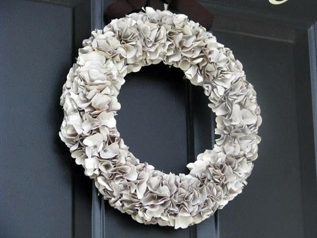 brown paper bag wreath on black door