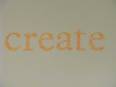 scrapbook lettering on wall spelling the word: create