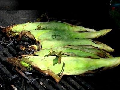 corn on grill still in husk
