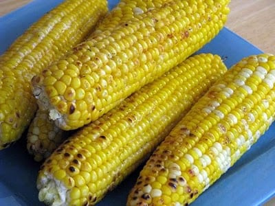 grilled corn on blue plate