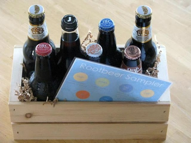 wooden crate with rootbeer bottles and laminated card