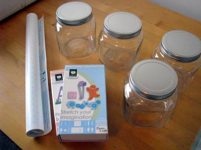 4 jars and a roll of contact paper on table