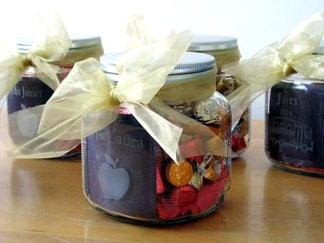 4 acid etched jars wrapped with ribbon