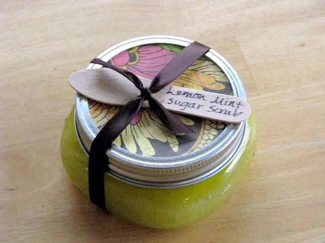 jar of sugar scrub with wooden spoon