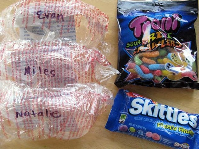 3 pairs of safety goggles and bag of skittles