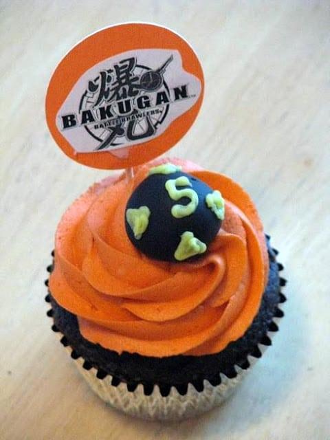chocolate bakugan cupcake with orange frosting