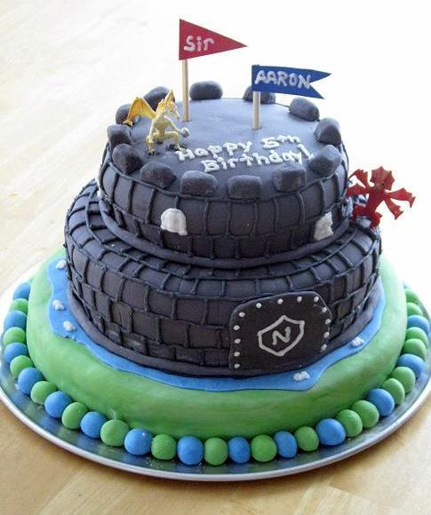 castle themed birthday cake on round platter