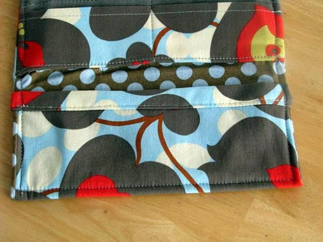 open fabric wallet with floral fabric