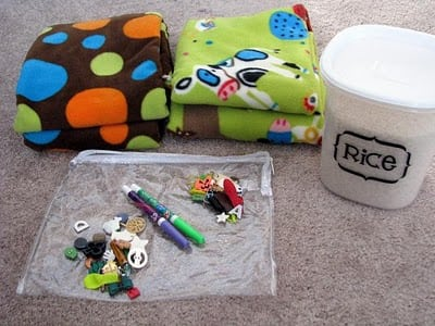 plastic pouch with small toys and fleece for I-spy bag