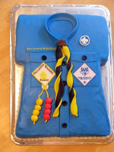 Cub Scout themed cake on silver baking sheet