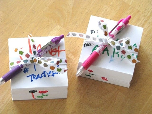 two white memo cubes wrapped in ribbon