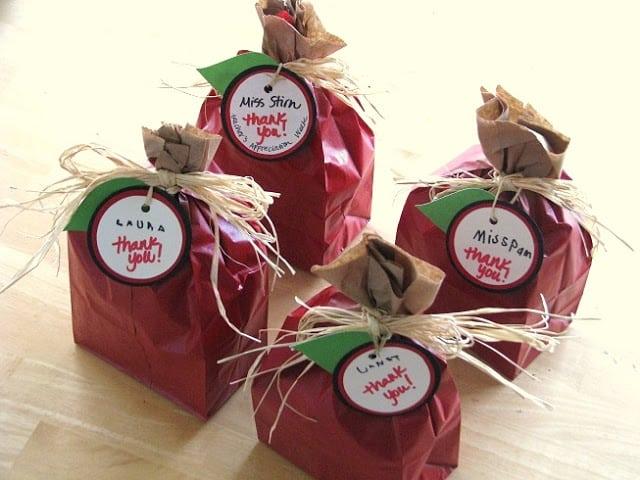 brown bags painted red to look like apples