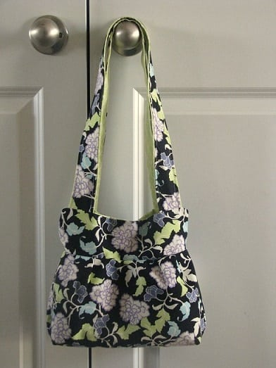 floral handbag hanging on door knob