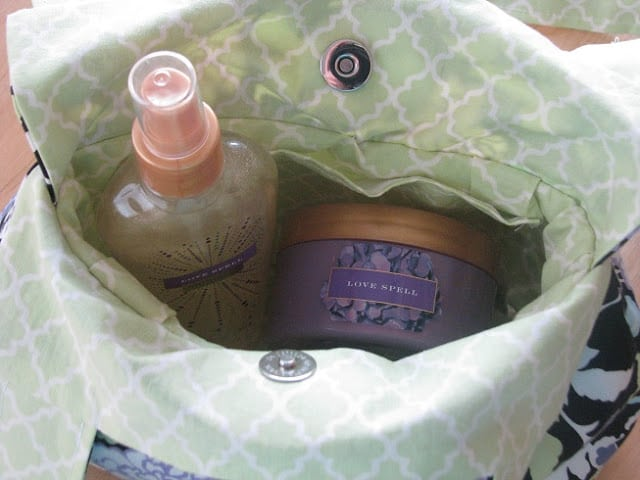 bottle of body spray and lotion inside handbag