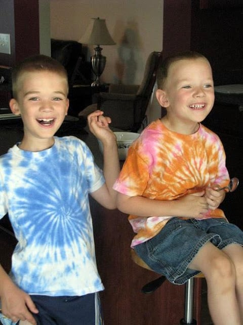 2 boys wearing tie dyed shirts