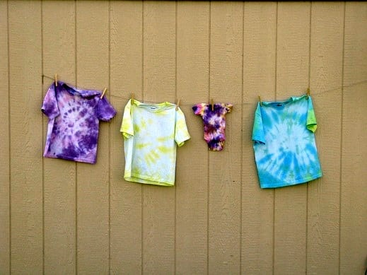 tie dyed shirts hanging on clothes line