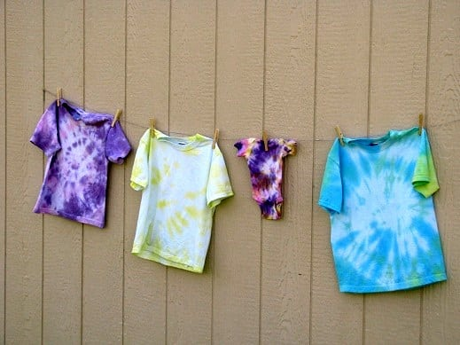 finished tie dyed shirts drying on clothesline