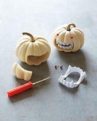 white mini pumpkins with white vampire teeth