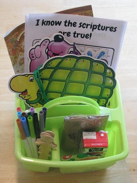 green tote with markers and activities and a juice box
