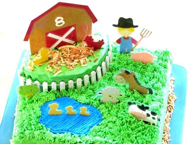 barnyard cake with barn and grass and laminated animals