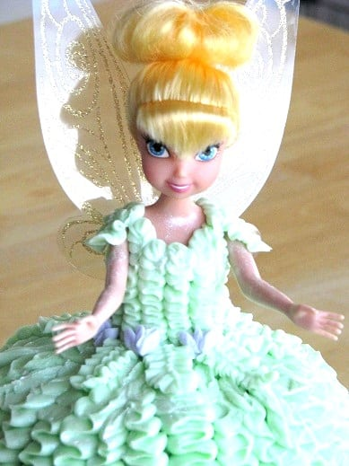 tinkerbell toy covered in frosting for tinkerbell cake