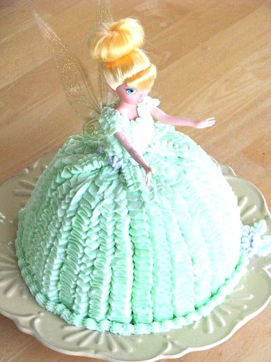 tinkerbell cake on green plate