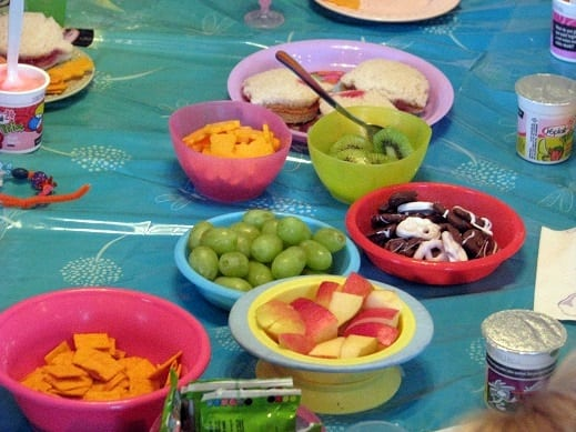 fruit and crackers and snacks in small bowls