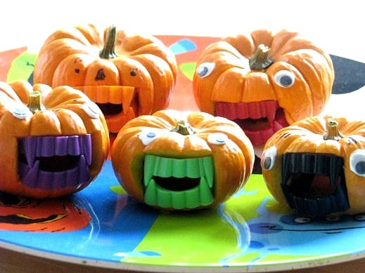 mini pumpkins on halloween platter