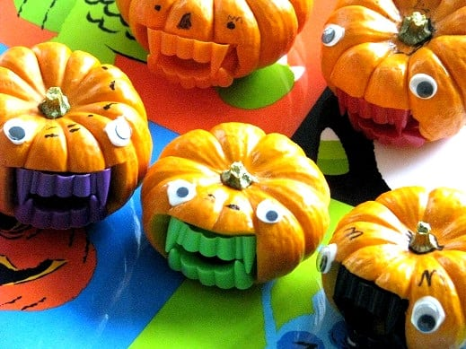 mini pumpkins with vampire teeth