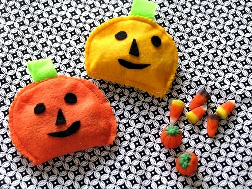 two candy pouches with candy corn on table cloth