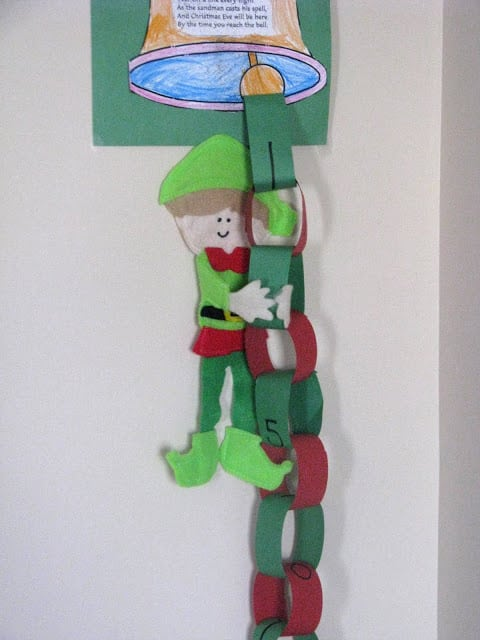 elf hanging on paper chain