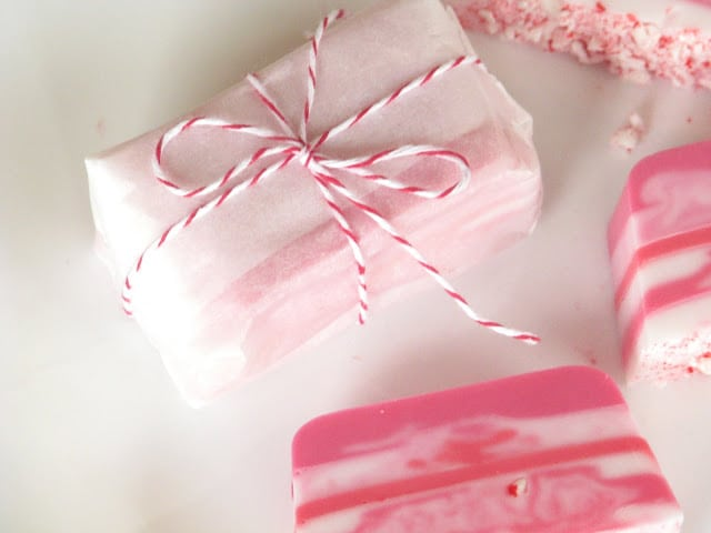 candy cane soap wrapped in parchment paper and tied with string