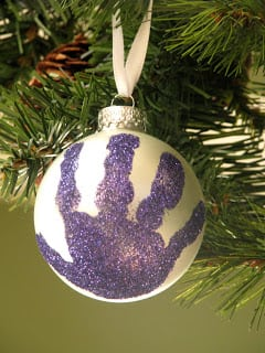 glass ornament with purple handprint