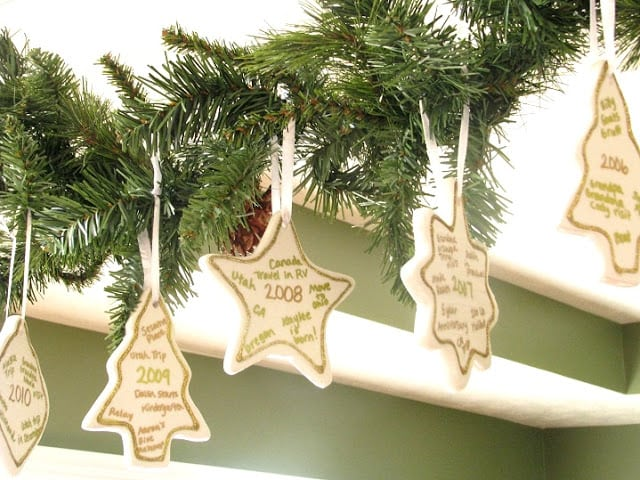 memory ornaments hanging on evergreen swag