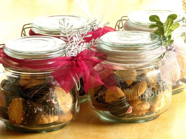 4 glass jars with chocolate dipped danish cookies