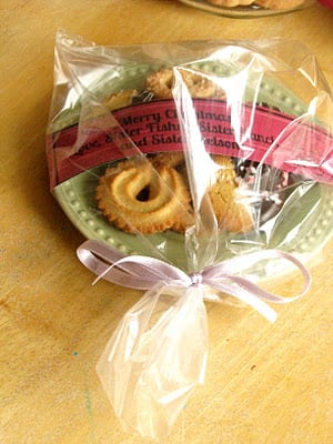 green plate wrapped in plastic with cookies
