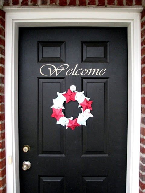 paper wreath on black door